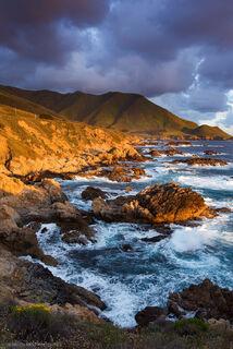 The Big Sur shoreline, specifically Garapada Headlands, boasts steep, dramatic cliffs, rocky shores, wildflower blankets and swirling ocean swells.