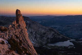The Eichorn Pinnacle of Cathedral Peak in Yosemite National Park glows at sunset.