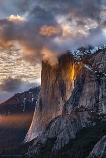 Horsetail Fall glows at sunset on the face of El Capitan in Yosemite Valley, Yosemite National Park.