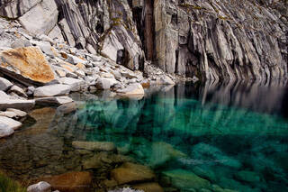 Precipice lake, a high alpine lake in Sequoia National Park, is the perfect meeting of granite and glacier-fed water.