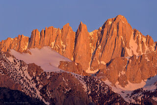 Mount Whitney Crest sunset alpenglow light and dusting of snow.