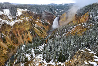 Upper falls of Yellowstone Falls in snow, Yellowstone National Park.