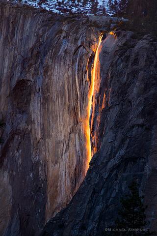 Horsetail Fall glows orange as it drops off El Capitan in Yosemite National Park
