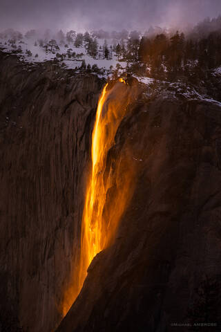 A photograph of the famous Horsetail Fall in Yosemite National Park, a waterfall flowing off El Capitan seasonally.