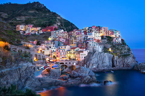 Italian Village of Manarola comes alive at dusk.