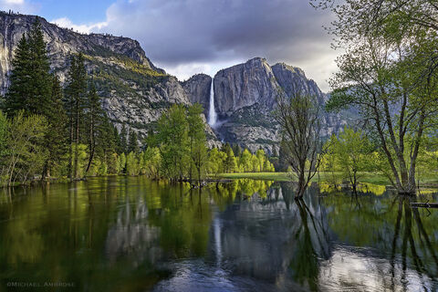 Reflections of Yosemite Falls crashing into the Merced River in Yosemite National Park in the Spring.