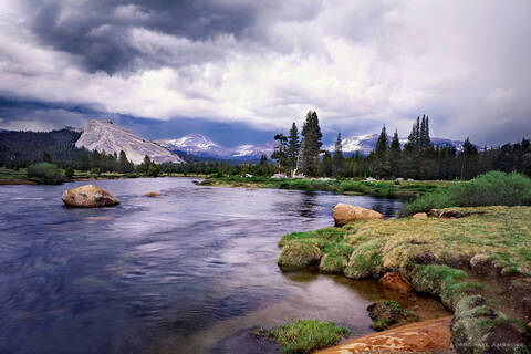 The Tuolumne River winds around Tuolumne Meadows and Lembert Dome in Yosemite National Park at sunset.