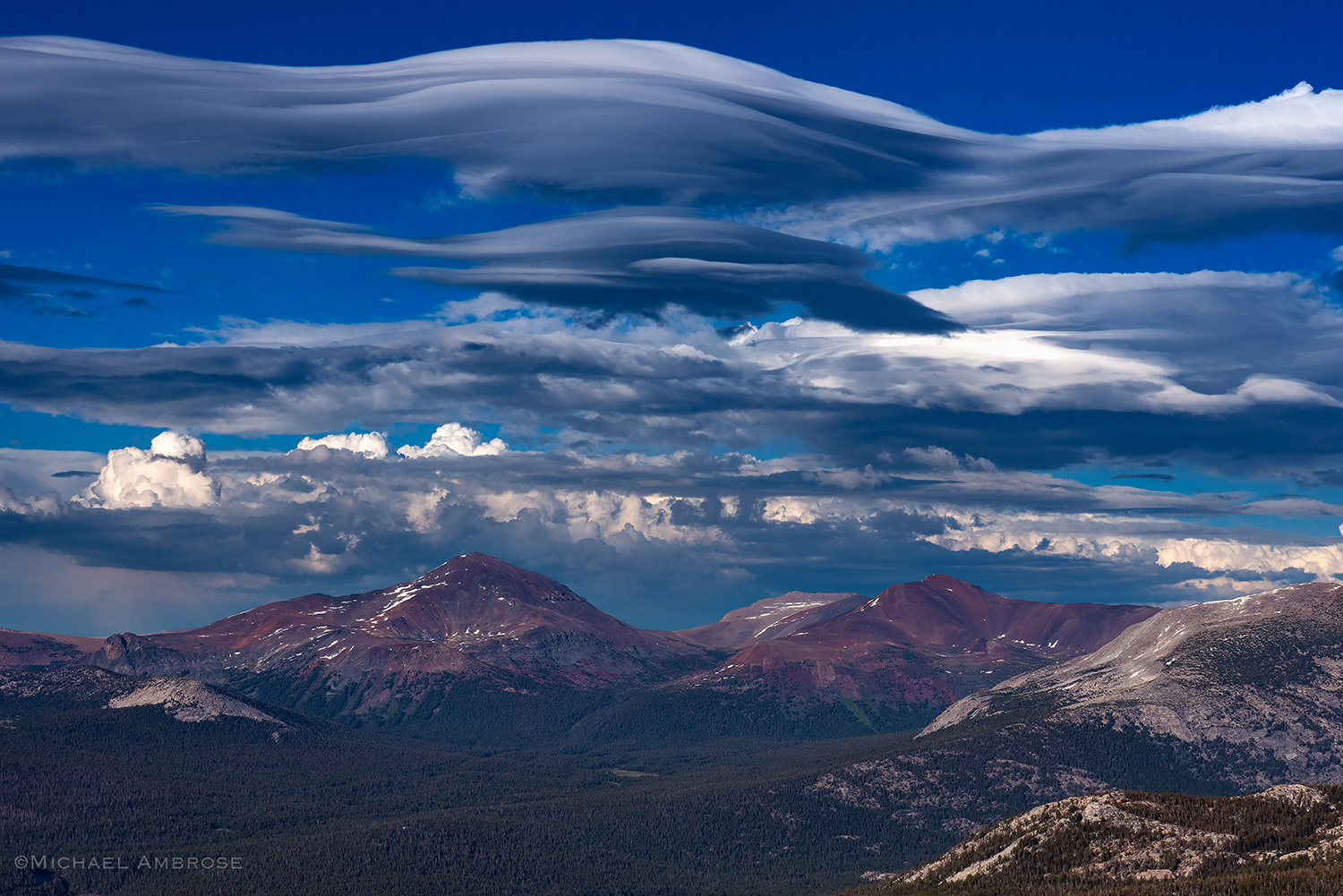 Lenticular clouds hover over the Dana Crest, in Yosemite National Park, as viewed from Upper Cathedral Peak.