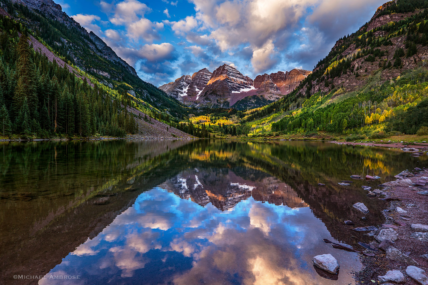 The Maroon Bells Mountains in autumn with a strong lake reflection, near Aspen, CO.