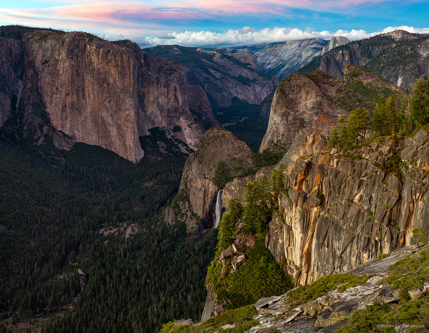 From Yosemite's Stanford Point, the view includes an eagle-eye spy of Bridalveil Fall, Sentinel Rocks, El Cap, Half Dome, and distant Tenaya Canyon.