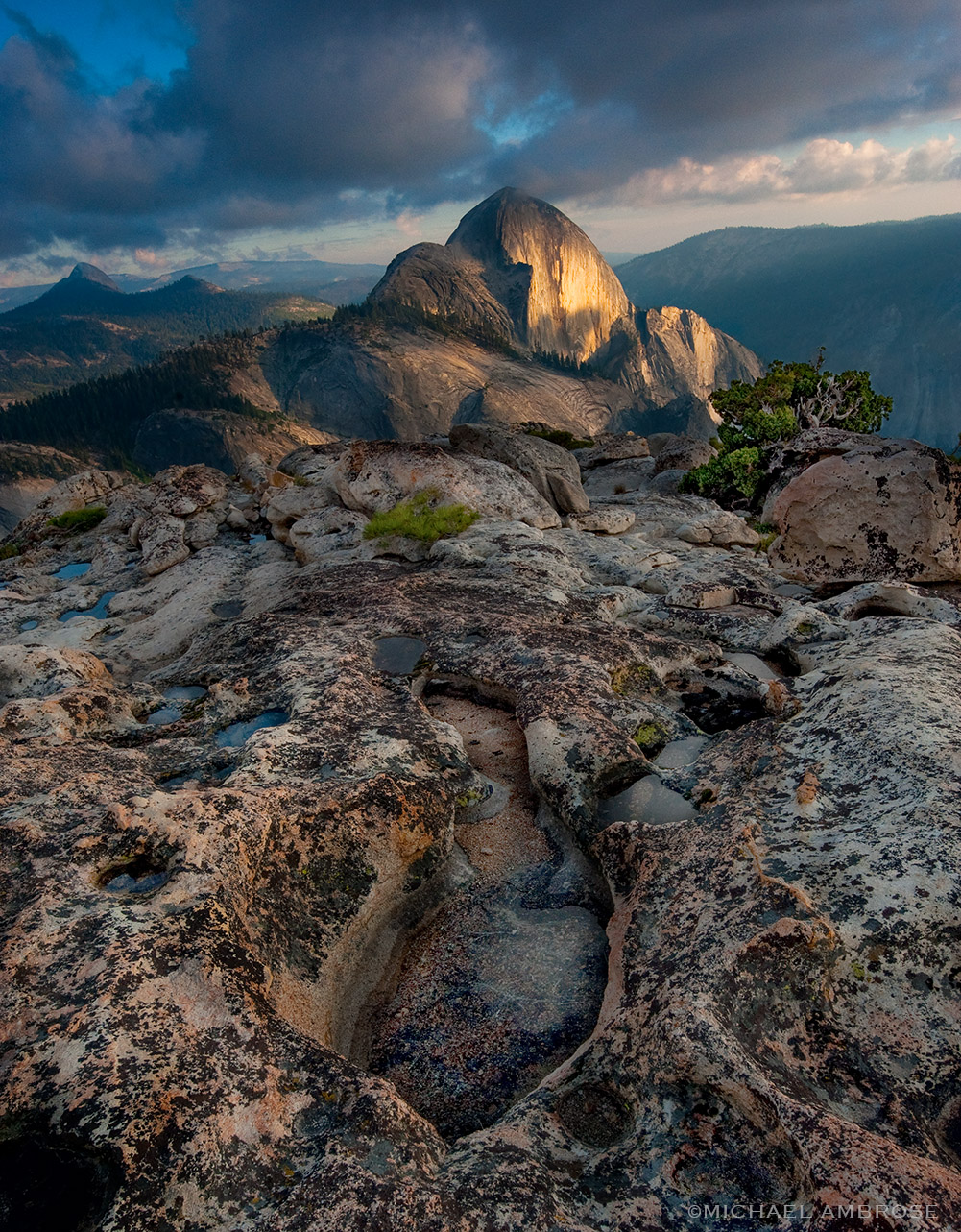 The back side of Half Dome as viewed from the summit of Mout Watkins at sunset in Yosemite National Park.