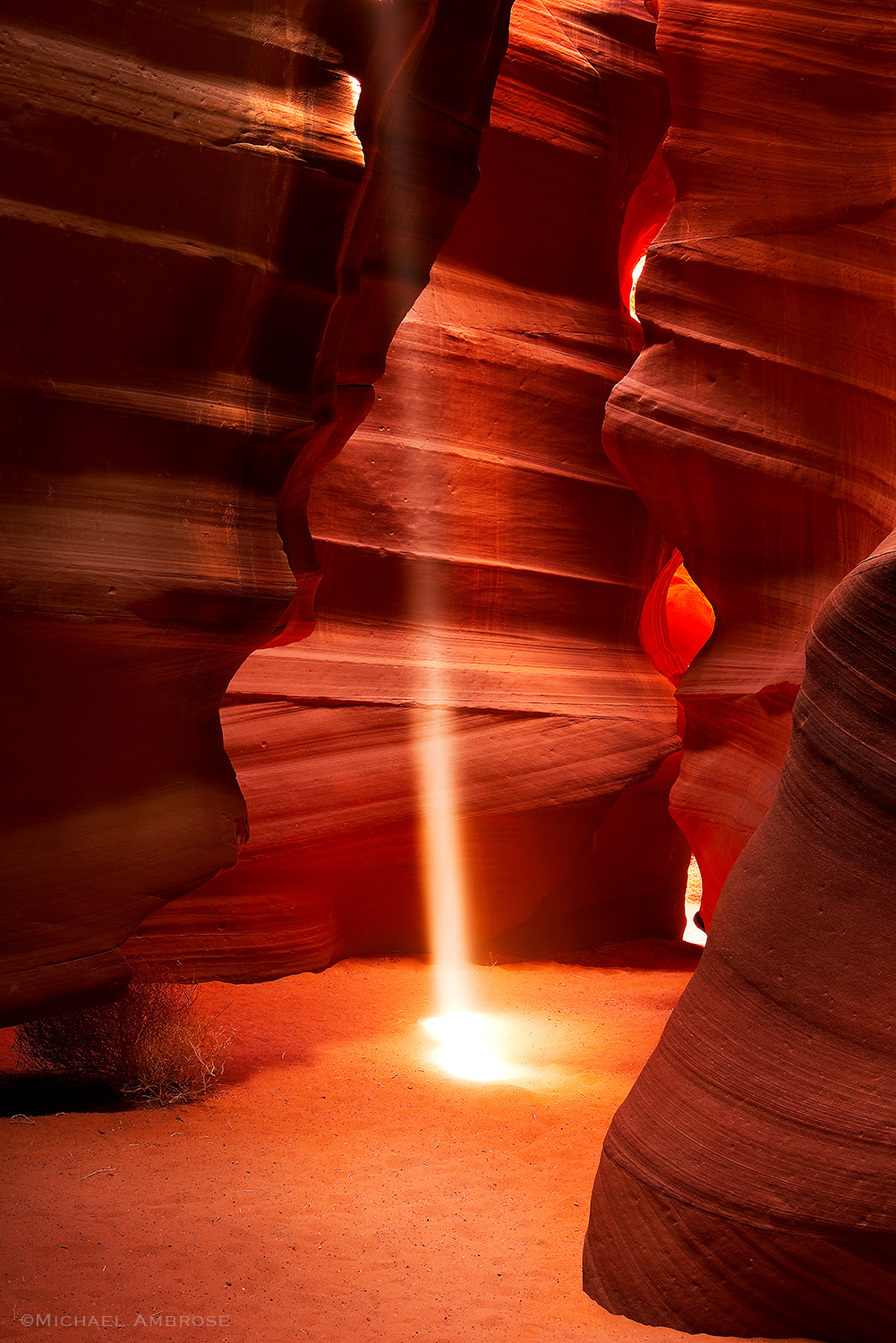 A beam of light cuts through the slot canyon of sandstone at Antelope Canyon in Page, Arizona.