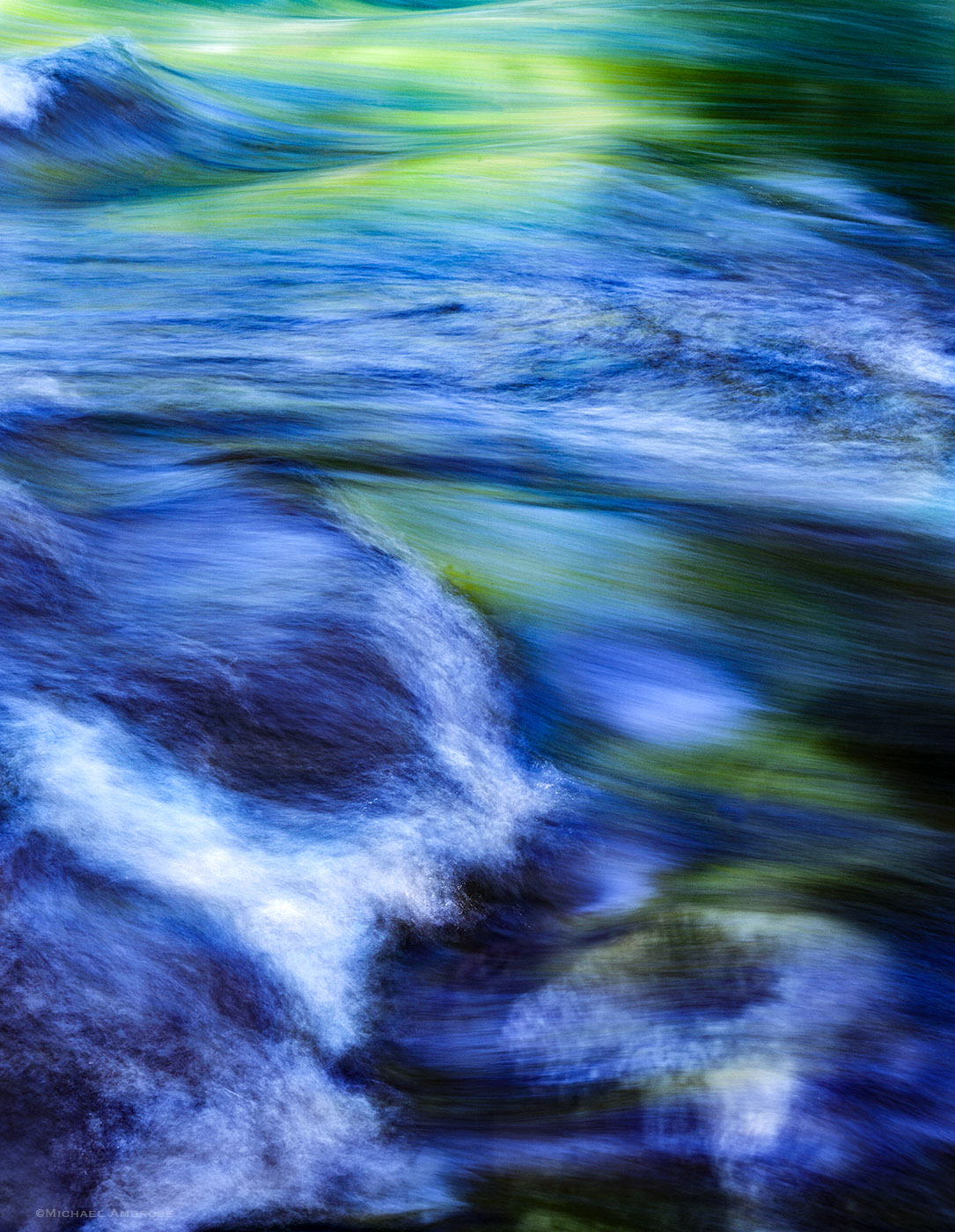 Vibrant green and blues mix in this long exposure of the Merced River in Yosemite Valley on a spring day.