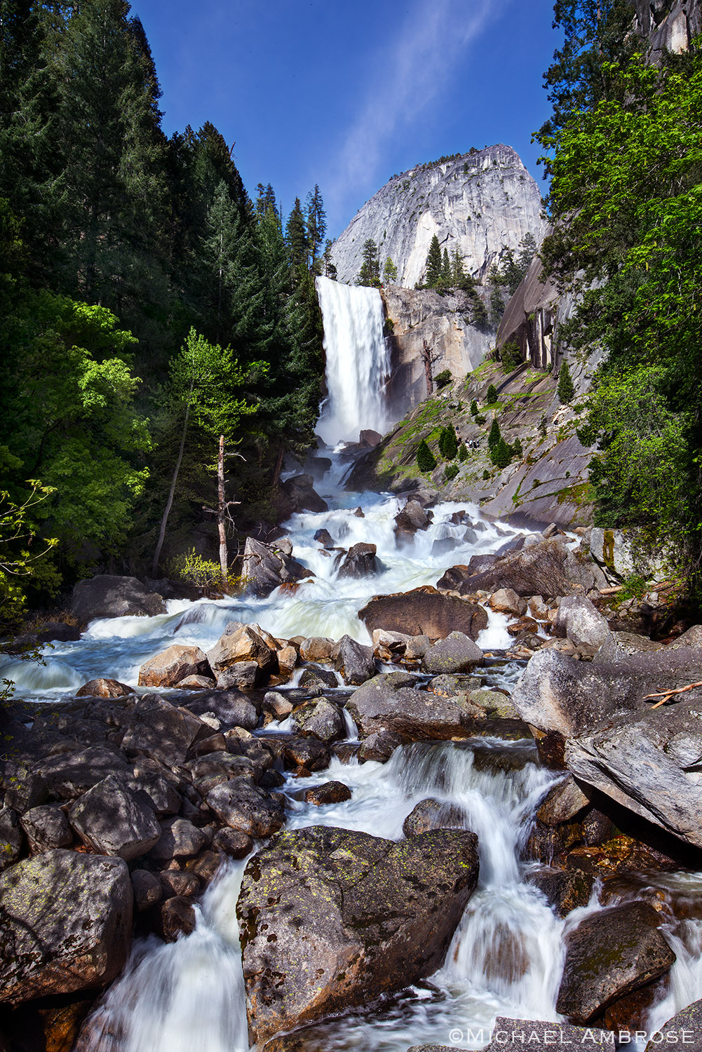 In the summer the Merced river water rushes over a cliff creating Vernal Fall in Yosemite National Park.